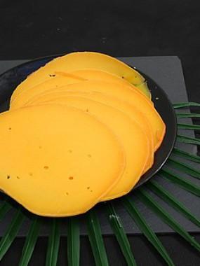 Mimolette tranche